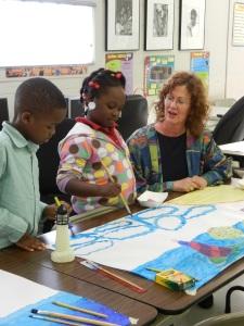 Susan teaching art at Volunteers of America